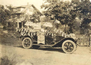 The Women's Club car with its president, Mme. Belle de Rivera at far left, 29 Dartmouth Rd in the background on July 4, 1915